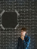 Business man, student or teacher hand on chin on brick wall notice board blackboard background Royalty Free Stock Image