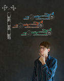 Business man, student or teacher hand on chin Formula 1 racing car fan on blackboard background Royalty Free Stock Image