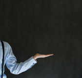 Man holding something or anything on blackboard background Royalty Free Stock Photo