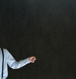 Man holding something or anything on blackboard background Royalty Free Stock Image