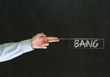 Man pointing fingers like a gun with bang sign Stock Photo