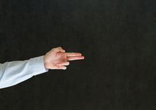 Man pointing fingers like a gun Royalty Free Stock Image