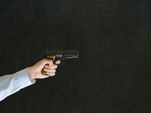 Man pointing a gun. Business man, student or teacher pointing a gun with copy space royalty free stock photos