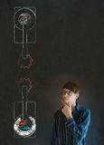 Man with North and South Korea conflict war tanks on blackboard background Stock Photos