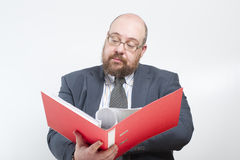 Business man studies folder with documents. Royalty Free Stock Photos