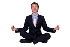 Business man in studio meditating Stock Image