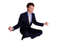 Business man in studio meditating Royalty Free Stock Image