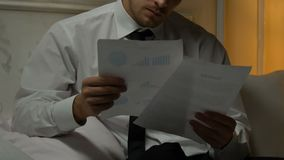 Business man studying documents at home, suffering from terrible headache stress. Stock footage stock video