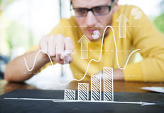 Business Man Studying The Graph Stock Images