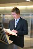 Business Man Studying in Library. A business man doing research in the library Stock Images