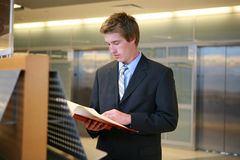 Business Man Studying in Library. A business man doing research in the library Royalty Free Stock Photography