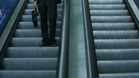 Business man in stylish black suit moves down on escalator.  stock video