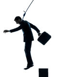 Business man suicidal hanging silhouette Stock Photo