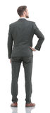 Business man in suit  from the back - looking at something over Stock Photo