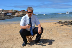 Business man in suit on the beach calling by mobil Royalty Free Stock Images