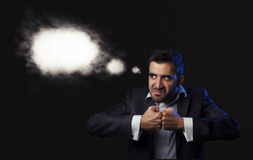 Business man in suit being angry Royalty Free Stock Photos