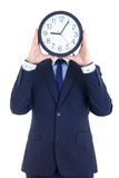 Business man in suit with clock covering face isolated on white Royalty Free Stock Photos
