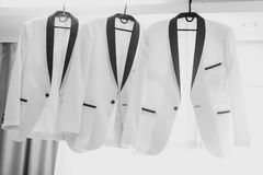 Business man suit clothes hanging. groom jacket.  Royalty Free Stock Images
