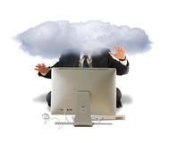 Man using computer with his head in the clouds Royalty Free Stock Images