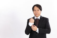 of business man in suit correcting a sleeve Royalty Free Stock Photography