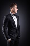 Business man in suit on a dark background Royalty Free Stock Photography