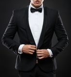 Business man in suit on a dark background Stock Image