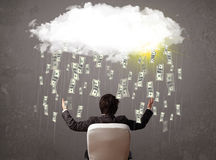 Business man in suit looking at cloud with falling money. And sun royalty free stock photo