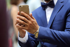 Business man in suit with mobile phone in hand Royalty Free Stock Images