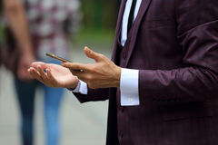 Business man in suit with mobile phone in hand Stock Photo