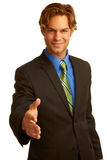 Business man in suit offering a handshake Royalty Free Stock Image