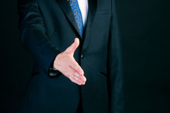 Business man in suit offering handshake Royalty Free Stock Photography
