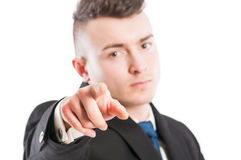 Business man with suit poiting finger at the camera Stock Image