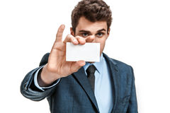 Business man in suit showing his blank business card ready for your text Royalty Free Stock Photos