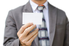 Business man in suit showing his business card Royalty Free Stock Photos