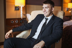 Business man in suit sitting in chair Royalty Free Stock Images