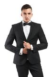 Business man in a suit straightens his jacket Royalty Free Stock Images