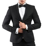 Business man in a suit straightens his jacket Stock Photos