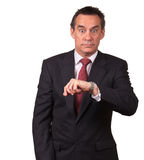Business Man in Suit Surprised at Time on Watch Royalty Free Stock Photos