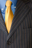 Business man Suit with yellow tie. Detail of a Business man Suit with yellow tie Royalty Free Stock Image
