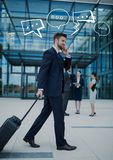 Business man with suitcase on phone with white speech bubbles. Digital composite of Business men with suitcase on phone with white speech bubbles Stock Images