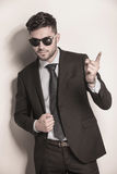 Business man with sunglasses pointing his finger Royalty Free Stock Photography