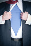 Business Man Superhero. Business man tearing shirt to become a superhero Royalty Free Stock Images