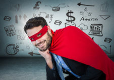 Business man superhero with head on hand against blue wall with business doodles and flare stock illustration