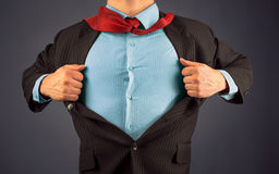 Business man superhero. Unrecognizable business man opens suit showing blue shirt, space for text Royalty Free Stock Photography