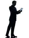 Business man  surprised digital tablet  silhouette. One caucasian business man surprised  holding digital tablet   in silhouette on white background Royalty Free Stock Photos