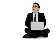 Business man surprised with laptop. Isolated business man surprised with laptop Royalty Free Stock Photos