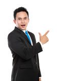 Business man surprisingly pointing at something Royalty Free Stock Photos