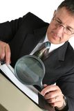 Business man at the table inspecting his results royalty free stock photos