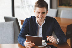Business man with tablet computer in cafe Royalty Free Stock Photo