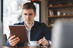 Business man with tablet computer in cafe Royalty Free Stock Image